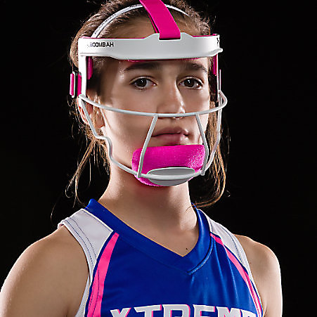 A girl wearing a white and pink softball face mask