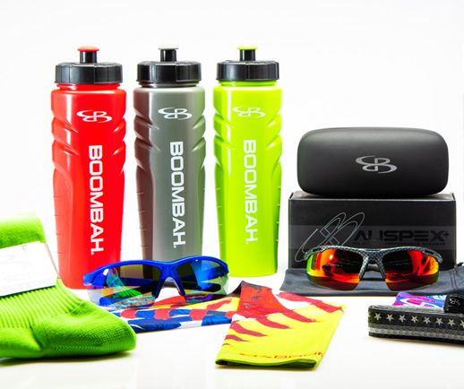 Assorted brightly colored Boombah accessories, including socks, water bottles and sunglasses.