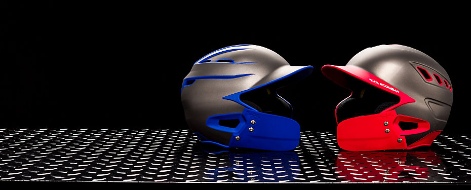 Two batting helmets, one red and one blue