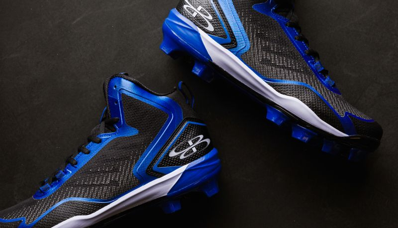Blue and black turf cleats