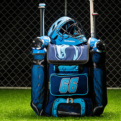 A blue bat bag filled with baseball gear