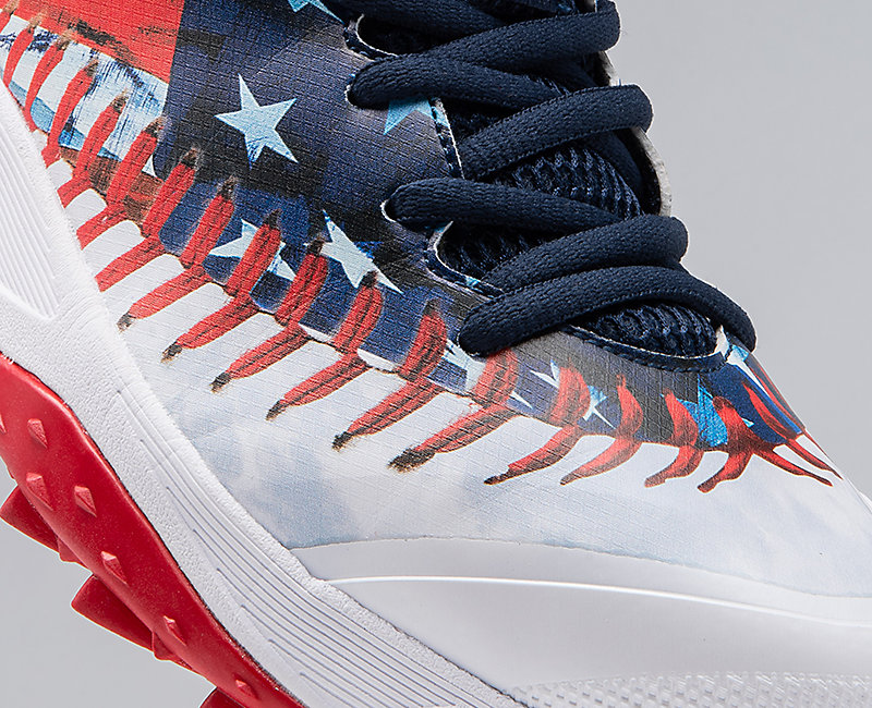 Red, white and blue Dart baseball shoe