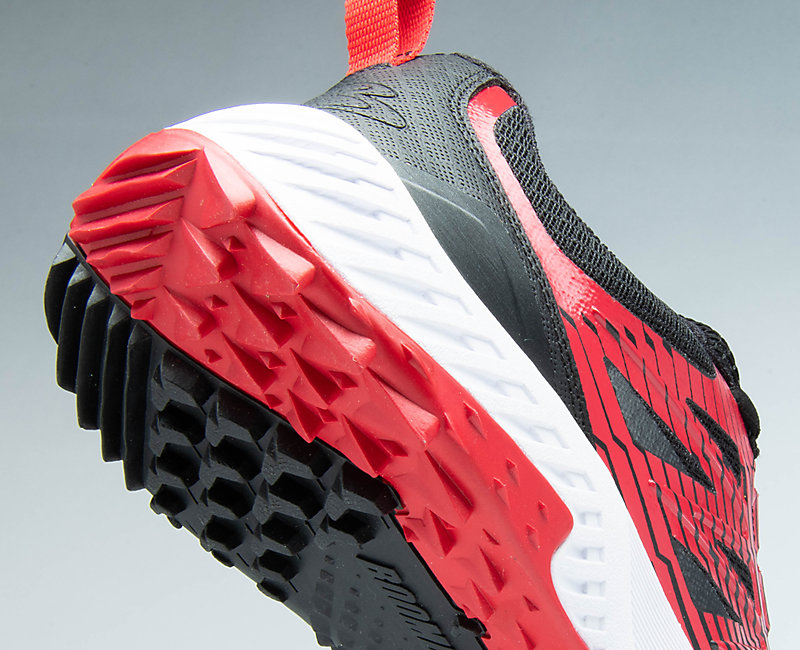 Red and black Challenger baseball shoe