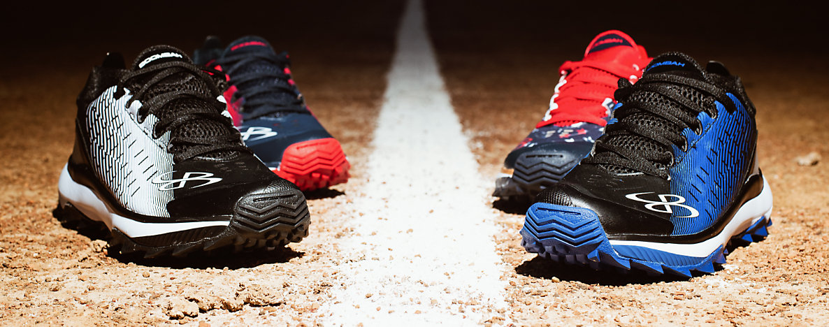 Four sports shoes on a baseball diamond