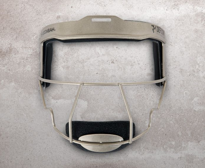 Grey and black fielder's mask against a concrete background
