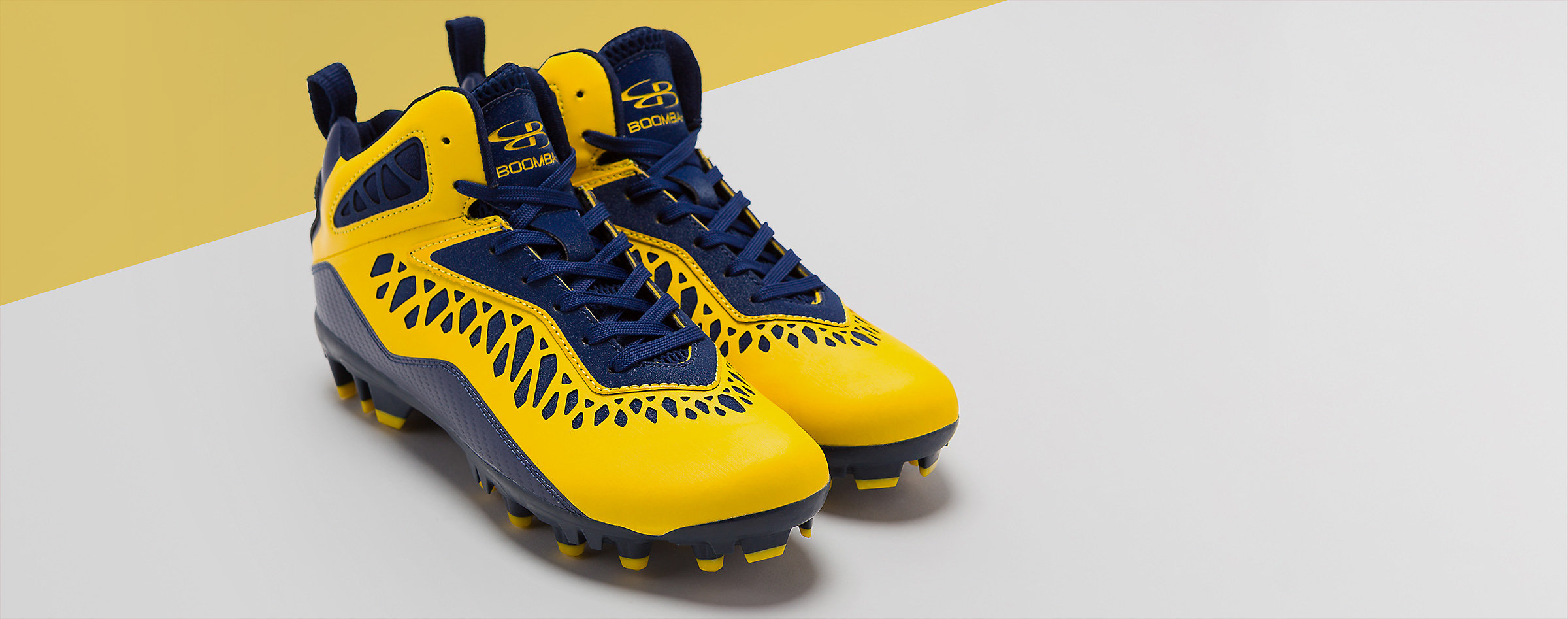 pair of yellow football cleats