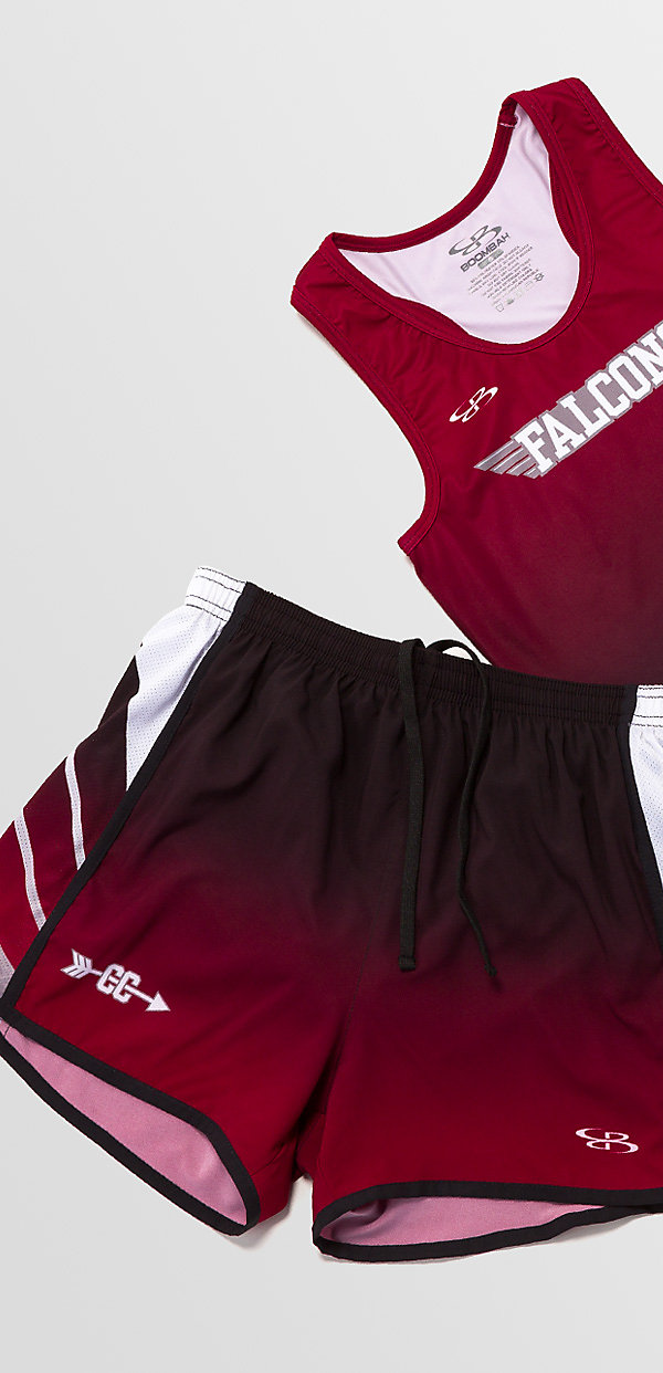 Custom red track jersey and shorts laying on a grey background