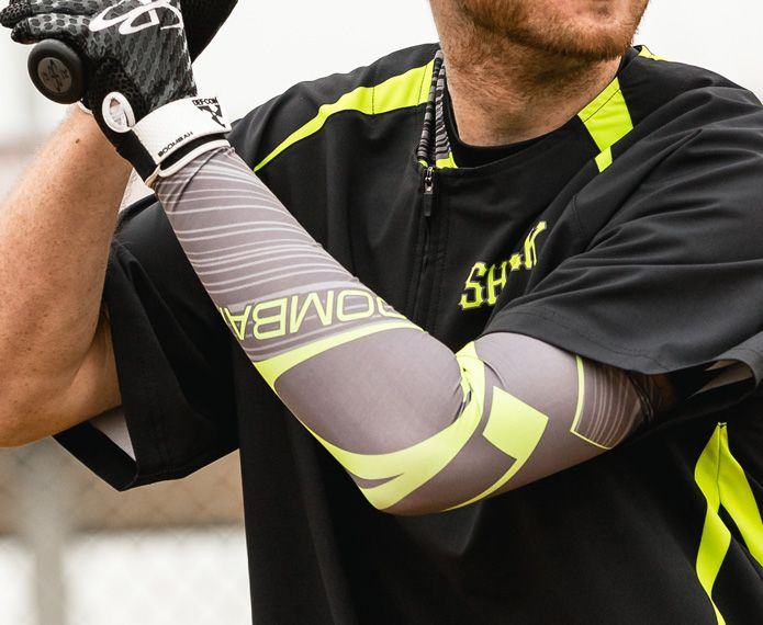 Batter wearing a black and neon shirt and a grey and neon branded arm sleeve