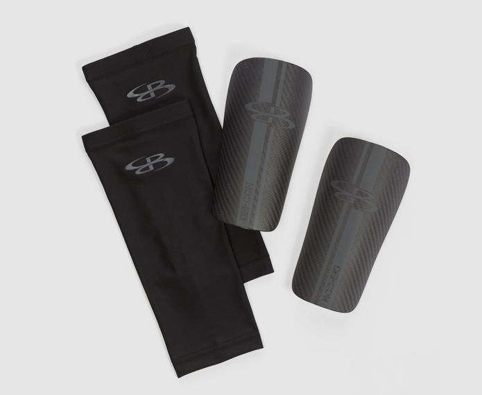 Black and grey branded shin guards