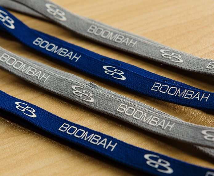 An assortment of blue and grey branded headbands